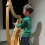 Mattias plays a harp at the music museum